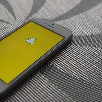 phone on table with snapchat on logo screen